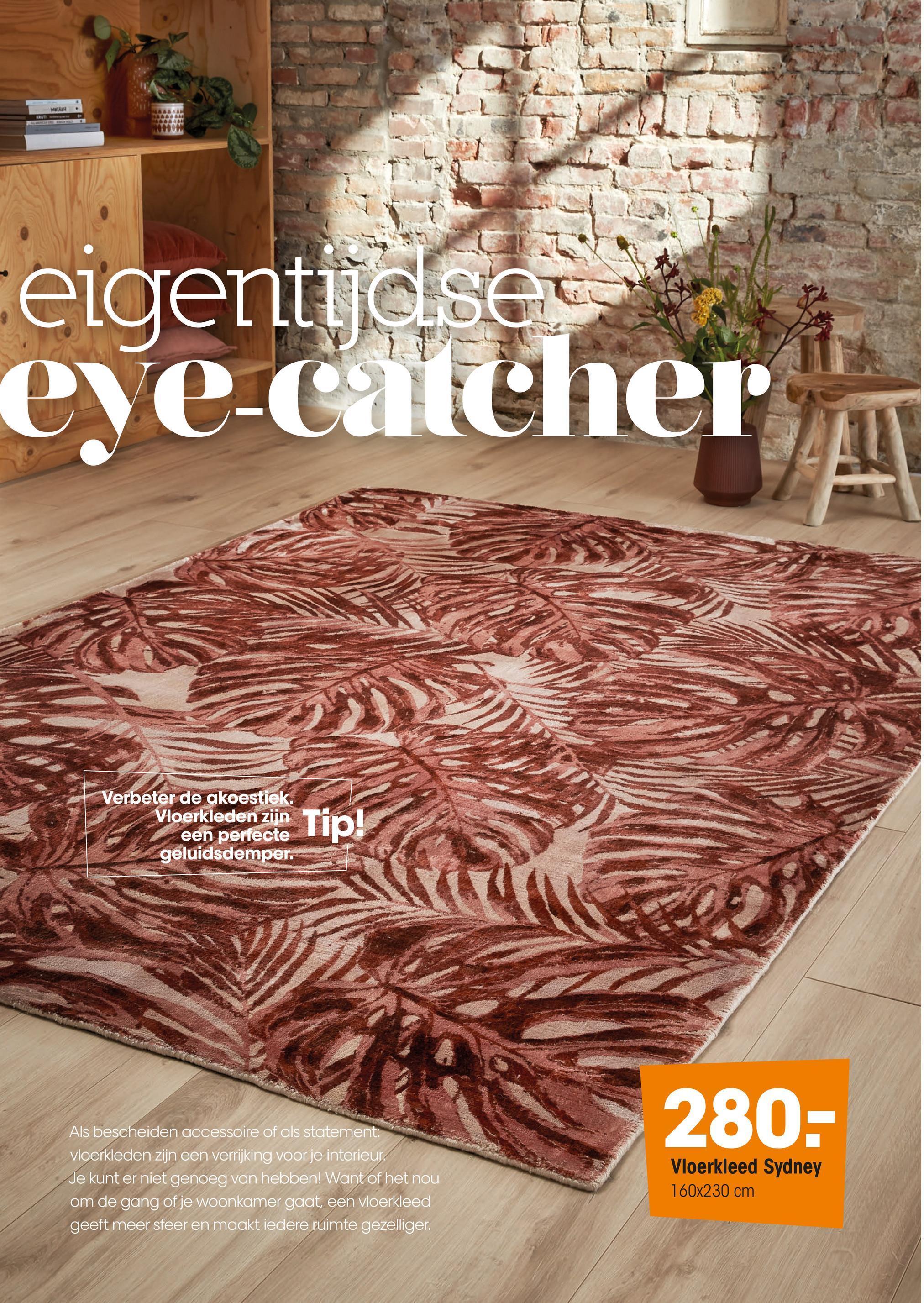 Vloerkleed Sydney Oranje Handgeweven vloerkleed van zacht materiaal met bladeren print. Voorzien van het Care & Fair keurmerk. Niet wasbaar. 230x160 cm (lxb).